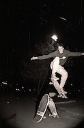 Skateboarder Tom Knox, who was recently sponsored by Santa Cruz Skateboards ollies two standing skateboards in a mall parking lot in Visalia, California in late 1987. Knox went on to be the one of the top rated street skaters in the world.