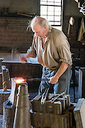 Blacksmith demonstration. Conner Prairie Interactive History Park provides family-friendly fun for all ages in Fishers, Indiana, USA. Founded by pharmaceutical executive Eli Lilly in the 1930s, Conner Prairie living history museum now recreates life in Indiana in the 1800s on the White River and preserves the William Conner home (listed on the National Register of Historic Places). For licensing options, please inquire.