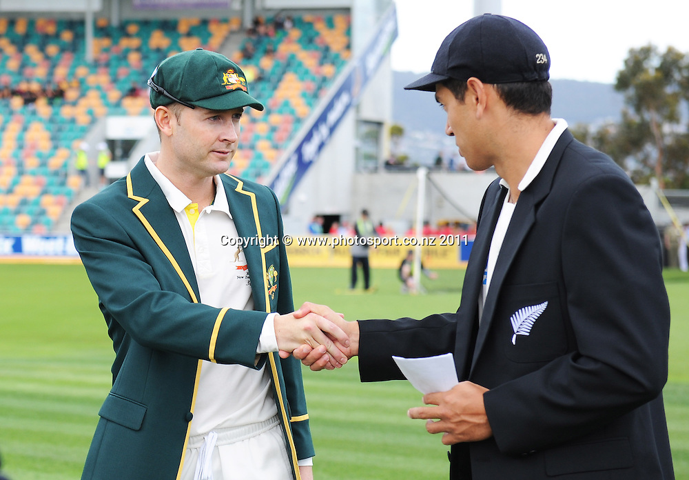 Michael Clarke shakes hands with Ross Taylor after winning the coin toss on Day 1 of the second cricket test between Australia and New Zealand Black Caps at Bellerive Oval in Hobart, Friday 9 December 2011. Photo: Andrew Cornaga/Photosport.co.nz