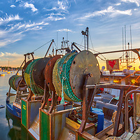 New England photography of Miss Emily at the Scituate Harbor in Scituate Massachusetts. The sunrise golden hour light beautifully painted this harbor scenery in warm hues and colors.<br />