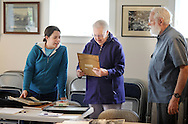 Allison Tyra, 26 of Doylestown, Pennsylvania shows some old photos found in her boyfriend's grandmother's house to Betty Strecker and Fletcher Walls at the Doylestown Historical Society Saturday April 25, 2015 Doylestown, Pennsylvania. (Photo by William Thomas Cain/Cain Images)