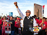 Culinary Union member Jose Rivera joins Trump International Hotel Las Vegas workers with other union supporters listen to speeches after marching down Las Vegas Blvd. to the hotel to convince their boss to start contract negotiations after they won a unionization vote on Wednesday, April 20, 2016.  (L.E. Baskow/Las Vegas Sun via AP) LAS VEGAS REVIEW-JOURNAL;MANDATORY CREDITS