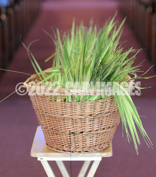 A basket of palm awaits distribution at St. Michael the Archangel Catholic Church after Palm Sunday services Sunday April 9, 2017 in Levittown, Pennsylvania. Palm Sunday commemorates Jesus' triumphal entry into Jerusalem. (Photo by William Thomas Cain)