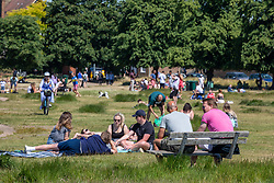 © Licensed to London News Pictures. 31/05/2020. London, UK. Members of the public go out in the sunshine on Wimbledon Common in South West London as weather experts predict another warm weekend with highs of 26c. On Monday, up to six people will be allowed meet up in parks and private gardens. Photo credit: Alex Lentati/LNP