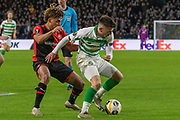 Ryan Christie (#17) of Celtic shields the ball during the Europa League match between Celtic and Rennes at Celtic Park, Glasgow, Scotland on 28 November 2019.