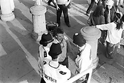 Raver conversing with police, 1st Criminal Justice March, Trafalgar Square, London, UK, 1st of May 1994.