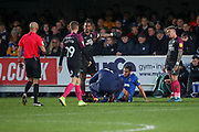AFC Wimbledon defender Nesta Guinness-Walker (18) down injured during the EFL Sky Bet League 1 match between AFC Wimbledon and Peterborough United at the Cherry Red Records Stadium, Kingston, England on 18 January 2020.