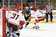 November 21, 2009:  BGSU's Nick Eno (31), Michigan wing David Wohlberg (25) and BGSU's Andrew Krelove (15) during the NCCA hockey game between Michigan and the Bowling Green State University at Lucas County Arena in Toledo, Ohio.