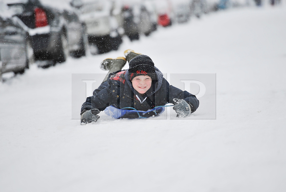 © Licensed to London News Pictures. 20 January 2013. Chipping Norton, Oxfordshire. Jago Williams (8). Probably the best Street in England for sledging? Residents of The Leys in Chipping Norton have made a super sledging run in the road. The local children even prevented council workers from salting the road by sitting down across the road to block the gritters. Everyone who live in the Leys seems to love the sledging run and have even joked that they want to apply for a ski lift to be installed for future years fun.. Photo credit : MarkHemsworth/LNP