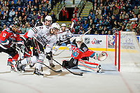 KELOWNA, CANADA, NOVEMBER 9: Colten Mayor #12 of the Red Deer Rebels takes a shot on net of Adam Brown #1 of the Kelowna Rockets as the Red Deer Rebels visit the Kelowna Rockets  on November 9, 2011 at Prospera Place in Kelowna, British Columbia, Canada (Photo by Marissa Baecker/Shoot the Breeze) *** Local Caption ***