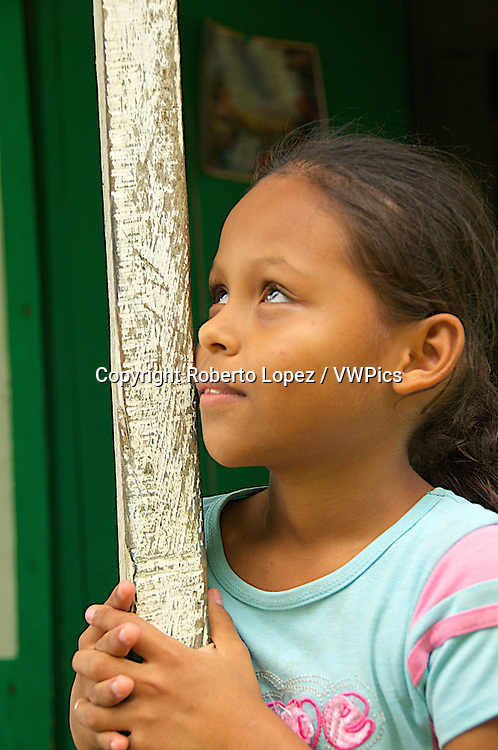 Little native girl at a house at a town in Heredia, Costa Rica.