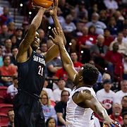 09 March 2018: San Diego State men's basketball takes on Nevada in the quarterfinal round of the Mountain West Conference Tournament. San Diego State Aztecs forward Malik Pope (21) attempts a step back jump shot in the first half with a Nevada defender in his face. The Aztecs cruise past the Wolfpack 90-73 to move on to the Championship game tomorrow afternoon at 3pm.<br /> More game action at www.sdsuaztecphotos.com
