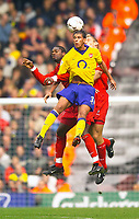 Photo. Jed Wee.<br /> Liverpool v Arsenal, FA Barclaycard Premiership, Anfield, Liverpool. 04/10/03.<br /> Arsenal's Jeremie Aliadiere (C) wins a three way contest for the ball with Liverpool's Salif Diao (L) and Sami Hyypia.