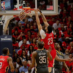 May 4, 2018; New Orleans, LA, USA; New Orleans Pelicans forward Anthony Davis (23) dunks over Golden State Warriors forward Kevon Looney (5) and forward Kevin Durant (35) during the second quarter in game three of the second round of the 2018 NBA Playoffs at Smoothie King Center. Mandatory Credit: Derick E. Hingle-USA TODAY Sports