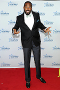 """Minnesota Timberwolves' Ronny Turiaf is seen on the red carpet at the Starkey Hearing Foundation's """"So the World May Hear"""" Awards Gala on Sunday, July 20, 2014 in St. Paul, Minn. (Photo by Diane Bondareff/Invision for Starkey Hearing Foundation/AP Images)"""