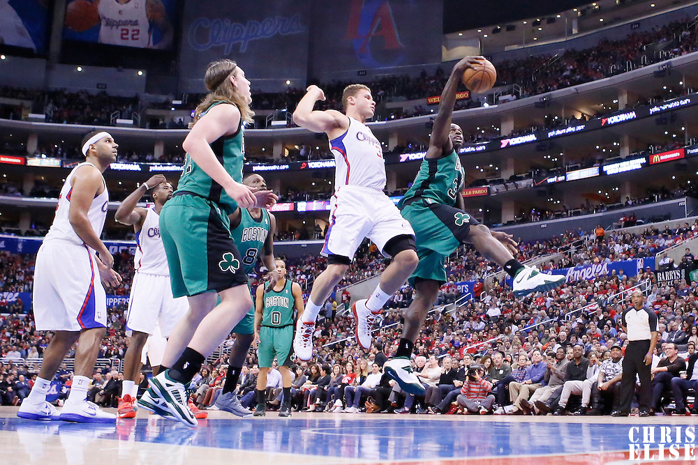 08 January 2014: Boston Celtics power forward Brandon Bass (30) grabs a rebound over Los Angeles Clippers power forward Blake Griffin (32) during the Los Angeles Clippers 111-105 victory over the Boston Celtics at the Staples Center, Los Angeles, California, USA.