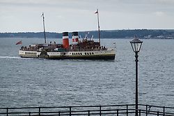 © Licensed to London News Pictures. 22/09/2016. Portsmouth, UK.  The world's last sea-going paddle steamer, Waverley, enters Portsmouth Harbour on her final day trip of the South Coast for 2016. This year marks 70 years since the Waverley's launch on 2nd October 1946. The paddle steamer is on a day excursion and will be sailing from Portsmouth to Lulworth Cove in Dorset via Yarmouth, Bournemouth and Swanage. She will then be sailing on excursions around the Thames estuary until 9th October 2016. Photo credit: Rob Arnold/LNP