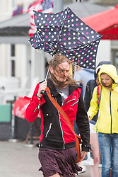 © Licensed to London News Pictures. 22/07/2017. Brighton, UK. members of the public take shelter as Brighton and Hove is hit by rain and powerful gusts of wind. Photo credit: Hugo Michiels/LNP