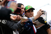 Sergio Perez (MEX) Sahara Force India F1 signs autographs for the fans.<br /> United States Grand Prix, Sunday 2nd November 2014. Circuit of the Americas, Austin, Texas, USA.