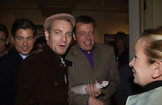 Chrissy Boy, Ewan McGregor and Suggs. Paul Simonon exhibition at Hazlitt Gooden and Fox Gallery and afterwards at the Ivy. 24 September 2002 © Copyright Photograph by Dafydd Jones 66 Stockwell Park Rd. London SW9 0DA Tel 020 7733 0108 www.dafjones.com