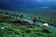 Tourists bicycling through the Connor Pass, County Kerry, Ireland