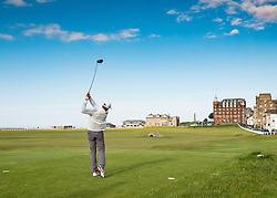 Golfer teeing off on 18th hole at Old Course in St Andrews in Fife , Scotland, United Kingdom