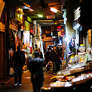 A night shot of a narrow alleyway at night next to the Spice Bazaar (also known as the Egyption Bazaar) in Istanbul, Turkey.