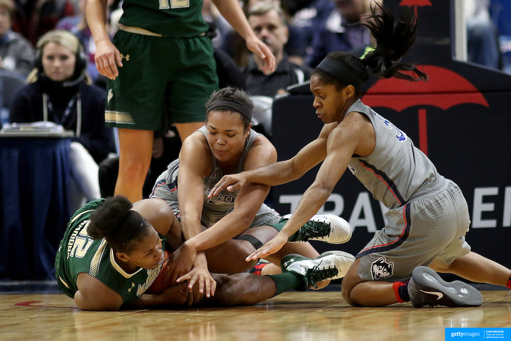 HARTFORD, CONNECTICUT- JANUARY 10: Nancy Warioba #32 of the South Florida Bulls is trapped by Napheesa Collier #24 of the Connecticut Huskies and Crystal Dangerfield #5 of the Connecticut Huskies during the the UConn Huskies Vs USF Bulls, NCAA Women's Basketball game on January 10th, 2017 at the XL Center, Hartford, Connecticut. (Photo by Tim Clayton/Corbis via Getty Images)