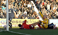 Photo: Ashley Pickering.<br />Southend United v Leicester City. Coca Cola Championship. 03/03/2007.<br />Iain Hume (yellow) slides in Leceister's second goal (1-2)