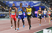 May 12, 2019; Yokohama, JPN; Machel Cedenio (TTO) and  Paul Dedewo (USA) run to the finish line in the 4 x 400m relay during the IAAF World Relays at International Stadium. Trinidad & Tobago won in 3:01.81. The United States was disqualified.