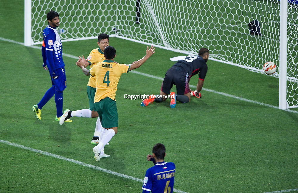 09.01.2015. Melbourne, Australia.  Massimo Luongo (2nd L) of Australia celebrates his goal during the opening football match against Kuwait at the AFC Asian Cup in Melbourne, Australia, Jan. 9, 2015. Australia won 4-1.