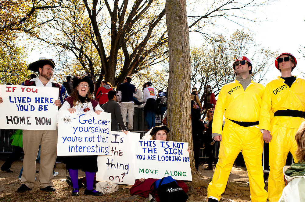Washington, DC, October 30, 2010 - Jon Stewert and Steven Colbert host the Rally To Restore Sanity and/or Fear.  Tens of thousands of ralliers donned costumes and carried signs.  Here, DEVO meets colonial protesters.