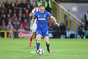 AFC Wimbledon defender Barry Fuller (2) dribbling during the The FA Cup match between AFC Wimbledon and Lincoln City at the Cherry Red Records Stadium, Kingston, England on 4 November 2017. Photo by Matthew Redman.