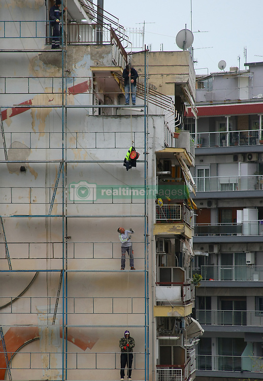 March 27, 2019 - Thessaloniki, Greece - Workers restoring a building in the city center of Thessaloniki , Chinese and Russian investors increasingly interested in local real estate as Greece has issued more than 3,000 residence permits to non-European Union nationals since the Golden Visa scheme was introduced. 27 March 2019. (Credit Image: © Grigoris Siamidis/NurPhoto via ZUMA Press)