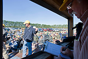 Lion's Club Secretary/Treasurer Gene Taylor keeps track of the winners inside the Auction trailer.