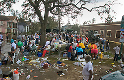 30 August, 2005. New Orleans Louisiana. Hurricane Katrina aftermath. <br /> Hundreds of desperate evacuees from the lower 9th ward await transportation to the Superdome where approximately 20,000 storm evacuees are housed.<br /> Photo Credit: Charlie Varley/varleypix.com