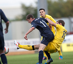 Falkirk's Conor McGrandles and Queen of the South's Michael Paton.<br /> half time : Falkirk 1 v 0 Queen of the South, Scottish Championship 5/10/2013.<br /> &copy;Michael Schofield.
