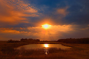 Sunset over pond<br /> Dubuc<br /> Saskatchewan<br /> Canada