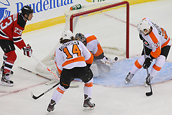 Jan 22, 2013; Newark, NJ, USA; New Jersey Devils center David Clarkson (23) scores a goal on Philadelphia Flyers goalie Ilya Bryzgalov (30) during the first period at the Prudential Center.