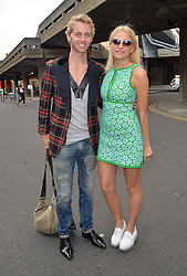 Singer Pixie Lott and Trent Whiddon attend the ISSA Spring/Summer 2015 Show during London Fashion Week in London, UK. 15/09/2014<br />BYLINE MUST READ : GOTCHAIMAGES.COM<br /><br />Copyright by © Gotcha Images Ltd. All rights reserved.<br />Usage of this image is conditional upon the acceptance <br />of Gotcha Images Ltd, terms and conditions available at<br />www.gotchaimages.com