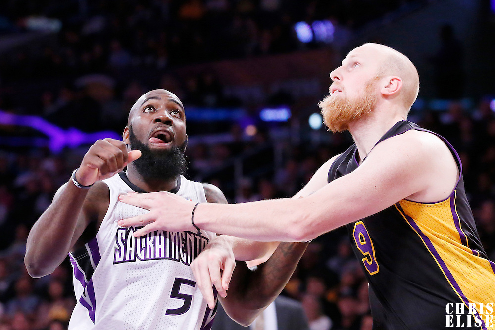 28 February 2014: Sacramento Kings small forward Quincy Acy (5) vies for the rebound with Los Angeles Lakers center Chris Kaman (9) during the Los Angeles Lakers 126-122 victory over the Sacramento Kings at the Staples Center, Los Angeles, California, USA.
