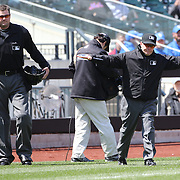 Umpires during the review pricess after the Braves score a run in the second inning when umpires ruled that Mets catcher Anthony Recker did not provide a clear lane for A.J. Pierzynski to score at home plate. Pierzynski was originally ruled out, but Braves manager Fredi Gonzalez challenged the call, and the ruling was overturned after a review during the New York Mets Vs Atlanta Braves MLB regular season baseball game at Citi Field, Queens, New York. USA. 23rd April 2015. Photo Tim Clayton
