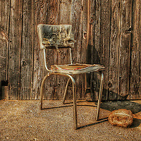 old bent broken chair with chrome legs