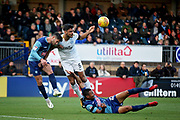 Peterborough United defender Ryan Tafazolli (5) wins this header during the EFL Sky Bet League 1 match between Wycombe Wanderers and Peterborough United at Adams Park, High Wycombe, England on 3 November 2018.