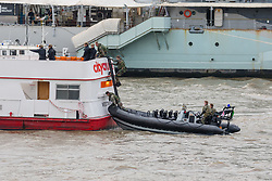 © Licensed to London News Pictures. 23/10/2018. London, UK. Royal Marines in a RIB with a ladder board a City Cruises passenger boat during a rehearsal for a display tomorrow when the Royal Marines and Royal Netherlands Marines will stage a joint on water capability demonstration with blank ammunition. As part of the Dutch state visit, King Willem-Alexander and Queen Máxima will attend the Dutch ship HNLMS Zeeland, which is anchored next to HMS Belfast. They will join The Duke of Kent on board and will be given a 10 minute display of the Royal Marines and Royal Netherlands Marines staging a joint on water capability demonstration.Photo credit: Vickie Flores/LNP