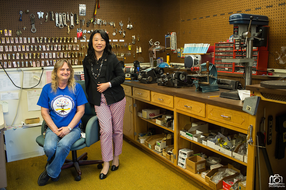 Mi;pitas Unified School District Assistant Superintendent Wendy Zhang and Locksmith Cindy Winborn pose for a portrait during Classified School Employee Week at MUSD MOT in Milpitas, California, on May 19, 2016. (Stan Olszewski/SOSKIphoto)