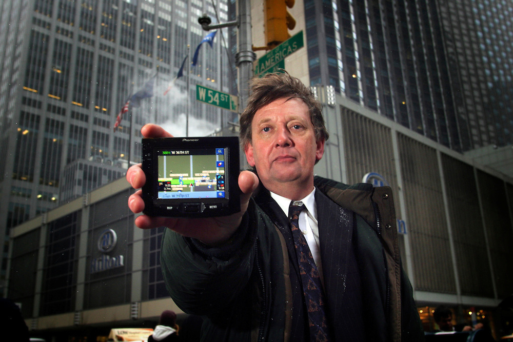 Paul Taylor reporter for the Financial Times checking new navigator gadgets the Pioneer AVIC-S1 on 57th street in Manhattan on Thursday  February 14 2007.