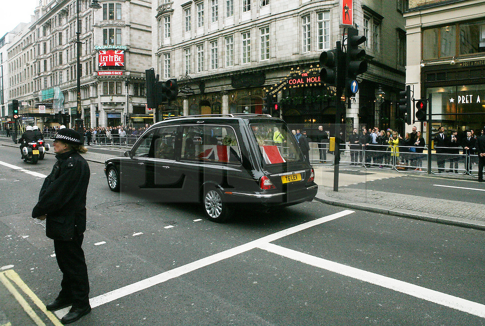 © Licensed to London News Pictures 17/04/2013.The coffin of the late Margaret Thatcher is drivne along the Strand, en route to St Paul's Cathedral where her funeral will take place..London, UK.Photo credit: Anna Branthwaite/LNP