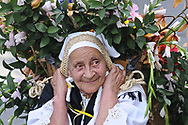 Elder peasant. Peasants or silleteros, continue the tradition of bringing from the mountains heavy flower bouquetes, before to to sell in town, nowadays to be part of the celebrations. Silleteros Parade at the Medellin flower festival