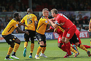 York City defender Dave Winfield grapples with Newport County defender Matt Partridge during the Sky Bet League 2 match between Newport County and York City at Rodney Parade, Newport, Wales on 5 September 2015. Photo by Simon Davies.